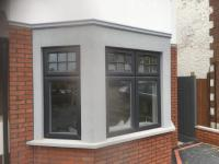 Outside completed with polymer render and brick slips.